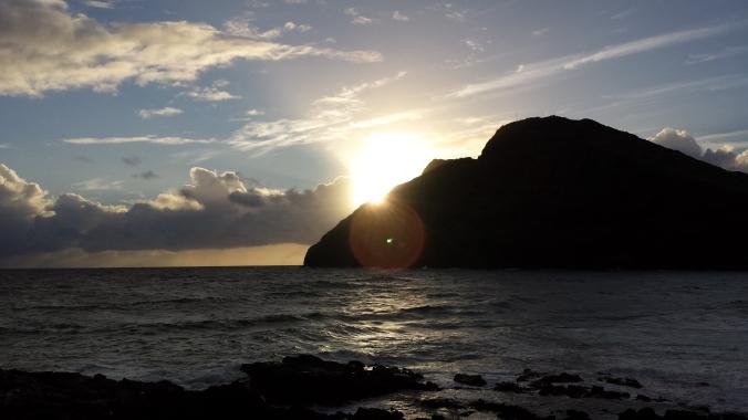 Sun Peaks Through the Rocks